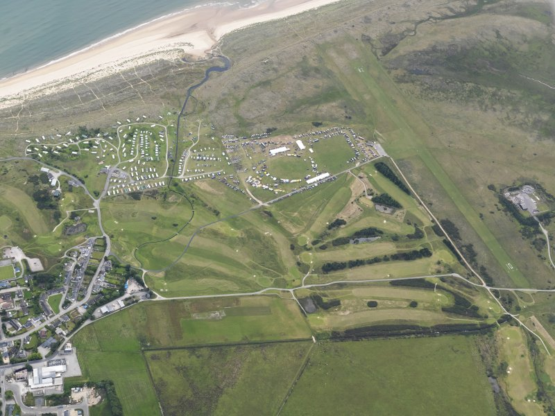 Oblique aerial view of Royal Dornoch golf course and airfield, looking ESE.