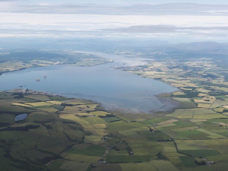 General oblique aerial view looking across Nigg Bay along the Cromarty Firth with Invergordon in the middle distance, looking WSW.