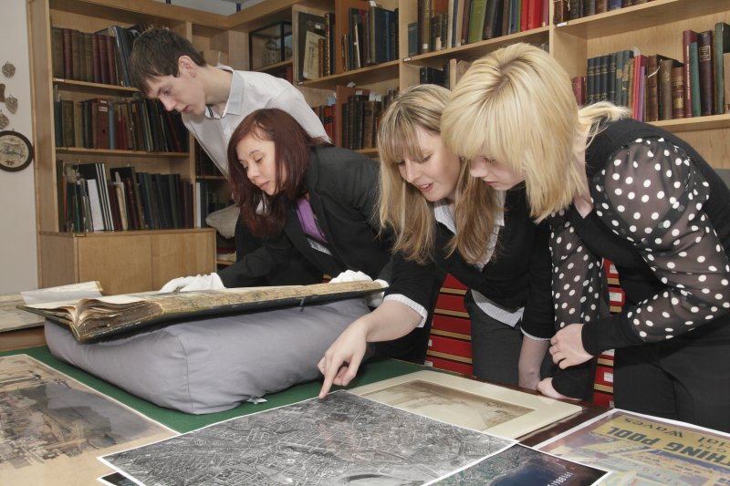 Skills for the Future trainees looking at archive material.