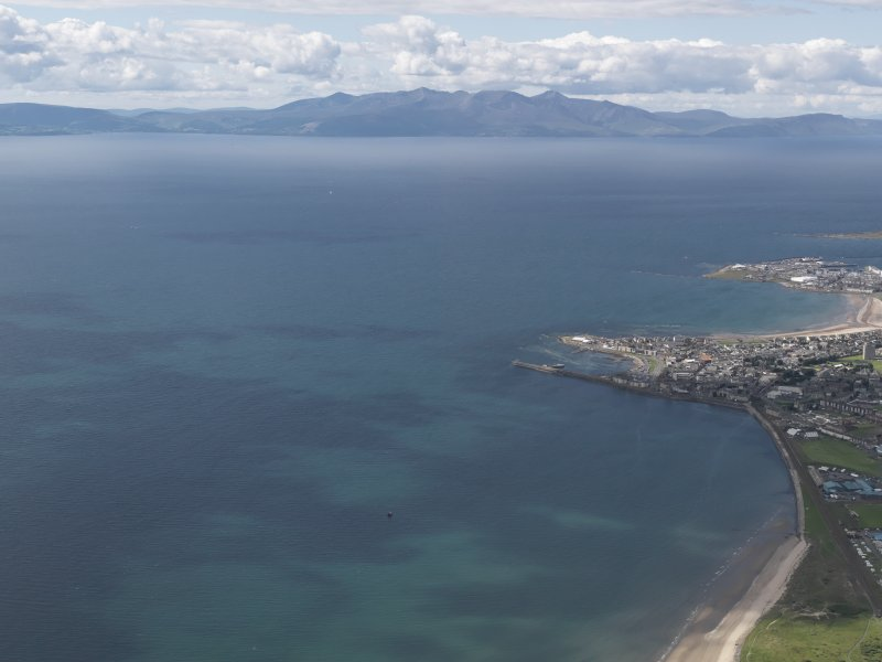 General oblique aerial view from the Ayrshire coast with Saltcoats and Ardrossan in the foreground and Arran beyond, looking to the NW.
