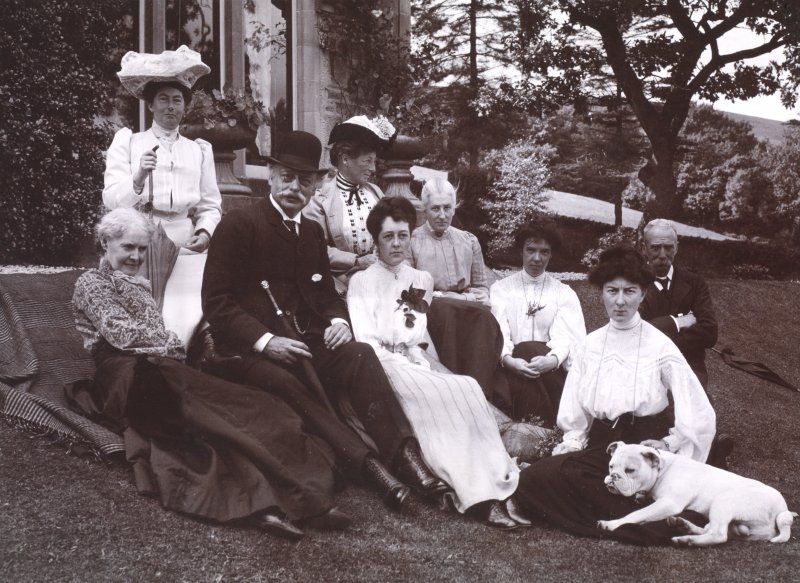 View of group of people sitting in garden. Titled: 'Aikenshaw July 1905. Miss Louise Stuart, Miss Grant, Mr Parker, Miss Parker, Francess, Mrs Jameson, Miss Davidson, Jessie, Mr W S Turnbull, Stronche ...