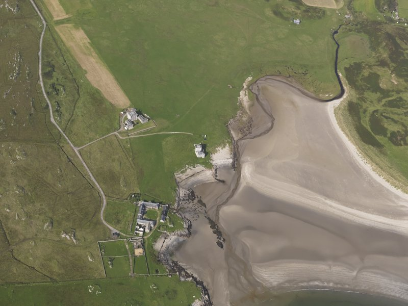 Oblique aerial view centred on Breachacha House, Col, looking to the NNE.