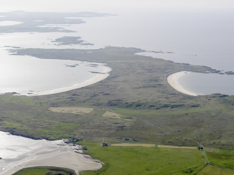 General oblique aerial view with Breachacha House, Col, in the foreground and Crossapol Bay, Feall Bay and Tiree beyond, looking to the W.