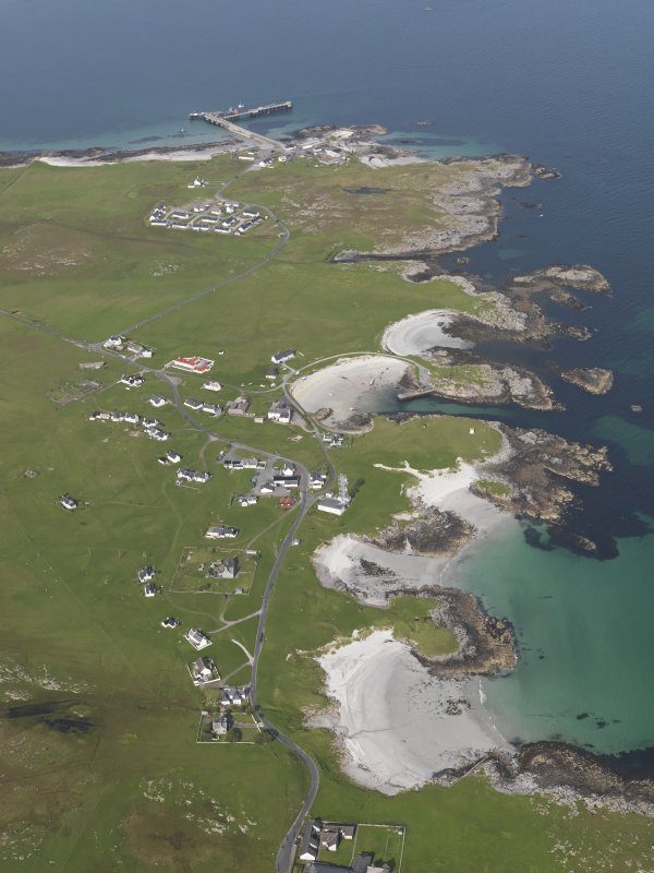 General oblique aerial view of Scarinish, Tiree, with the pier beyond, looking to the NE.