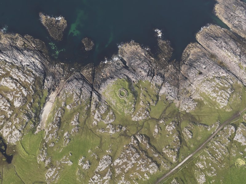 Oblique aerial view of the remains of Dun Mor Vaul broch, taken from the S.