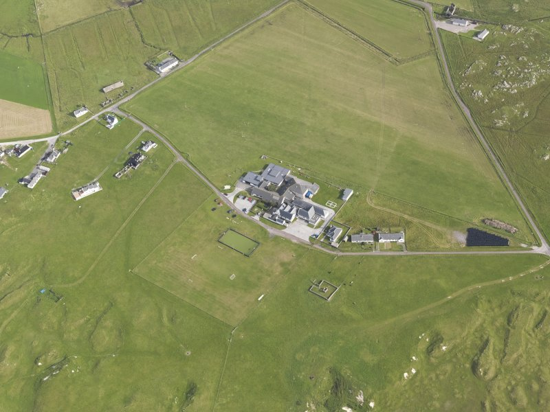 Oblique aerial view of Tiree High School, looking to the SE.