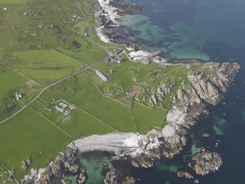 Oblique aerial view of Hynish, Tiree, looking to the NNE.