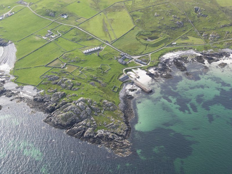 Oblique aerial view of Hynish, Tiree, looking to the WNW.
