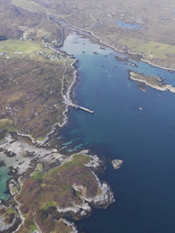 General olique aerial view of the bay at Aringour with Eilean Ornsay in the foreground, looking to the NNE.