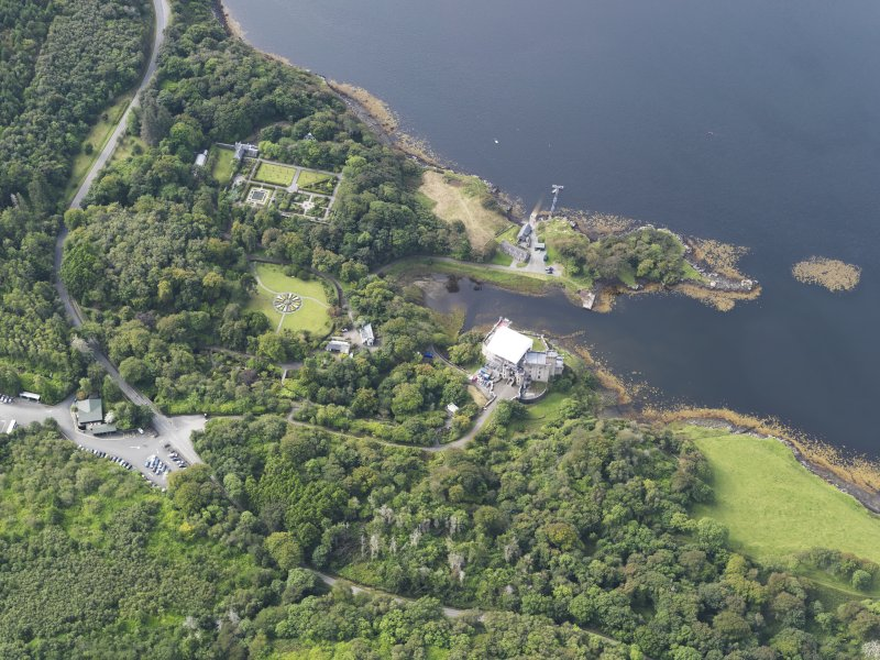 Oblique aerial view of Dunvegan Castle and gardens, looking SW.