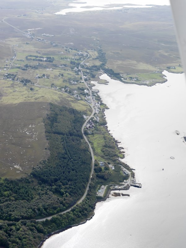 General oblique aerial view of Dunvegan Castle and gardens with Dunvegan village in the distance, looking SSE.