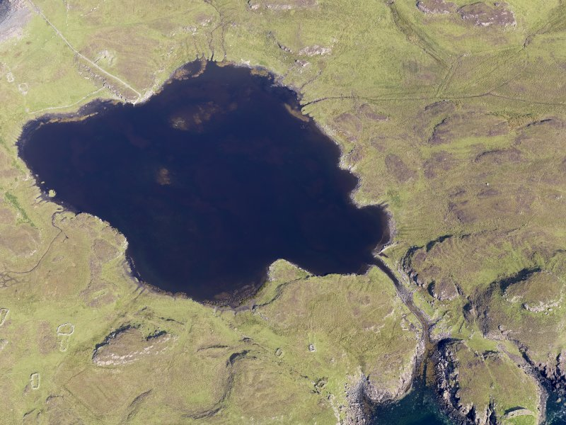 Oblique aerial view centred on Loch na h-Airde, the 'Viking Canal' and the remains of the dun at Rubh' an Dunain, taken from the SW.
