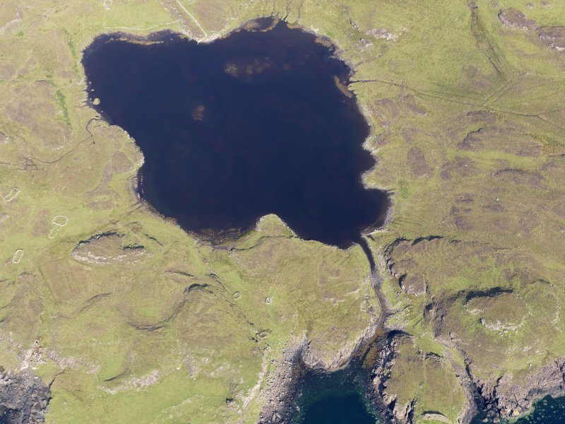 Oblique aerial view centred on Loch na h-Airde, the 'Viking Canal' and the remains of the dun at Rubh' an Dunain, taken from the SSW.