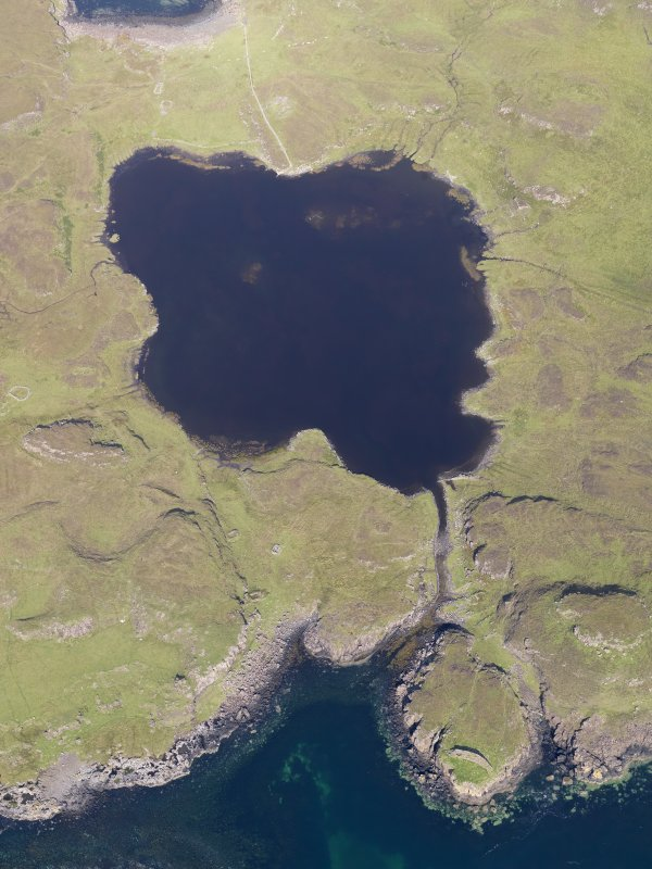 Oblique aerial view centred on Loch na h-Airde, the 'Viking Canal' and the remains of the dun at Rubh' an Dunain, taken from the S.