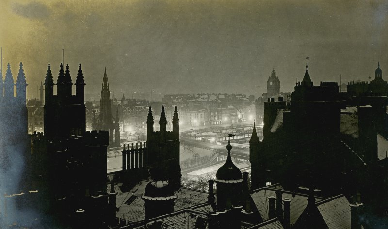 View towards Princes Street, Edinburgh at night Titled: 'Princes Street 11pm. November 1908, taken from the Outlook Tower, Castle Hill'. PHOTOGRAPH ALBUM No.30: OLD EDINBURGH ALBUM