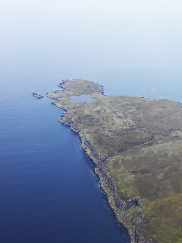 General oblique aerial view centred on the harbour at Loch na h-Airde, the 'Viking Canal' and Rubh' an Dunain, looking WSW.