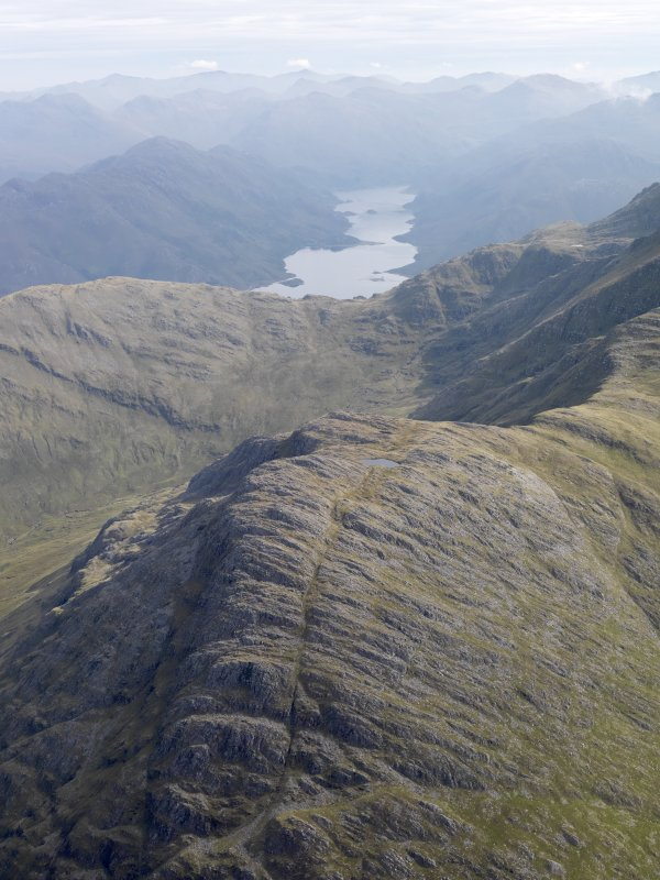 General oblique aerial view looking over Coire na Diollaide on the western flank of Ladhar Bheinn, Knoydart, with Loch Hourn beyond, looking E.