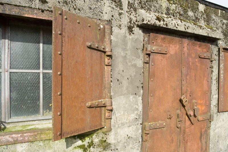 Gate buildings. Metal door and window shutters. Detail