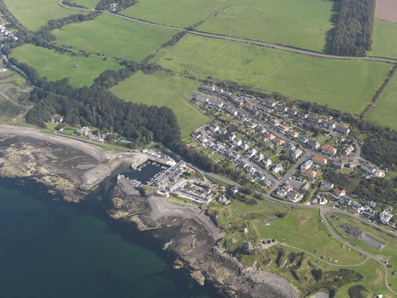 General oblique aerial view of Dunure with the castle in the foreground, taken from the W.