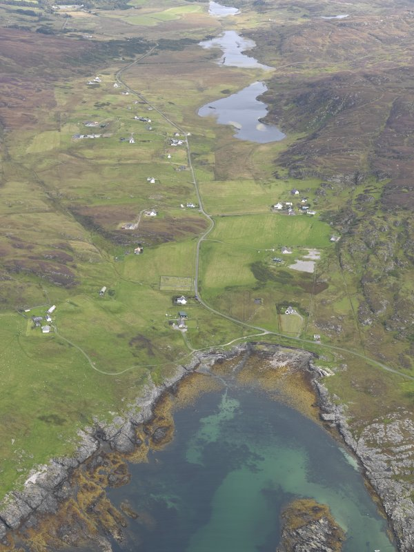 General oblique aerial view of Lower Kilchattan and Upper Kilchattan looking towards Loch Fada with the harbour in the foreground, taken from the SW.