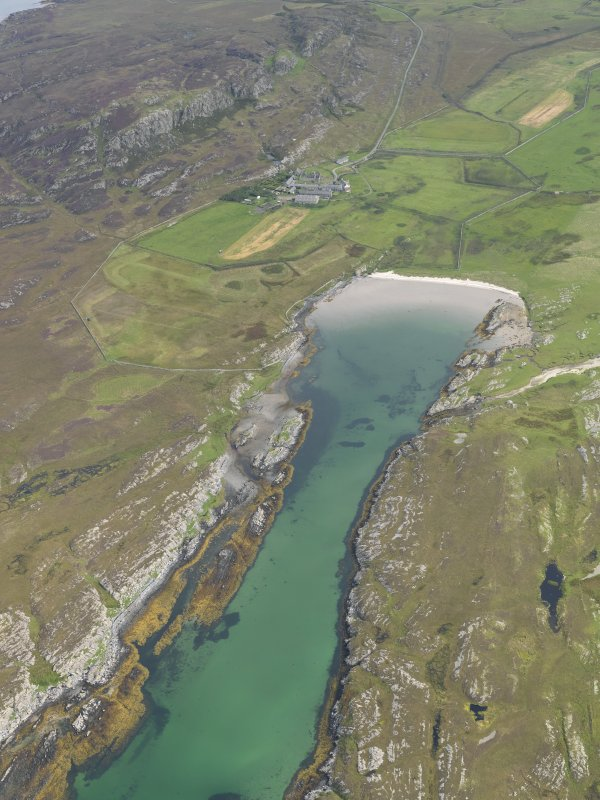 Oblique aerial view of Oronsay Farm and Priory, taken from the W.