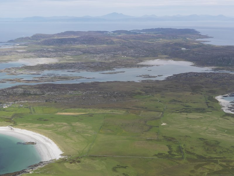 General oblique aerial view of Oronsay Nature Reserve looking towards Colonsay and Mull, taken from the SW.
