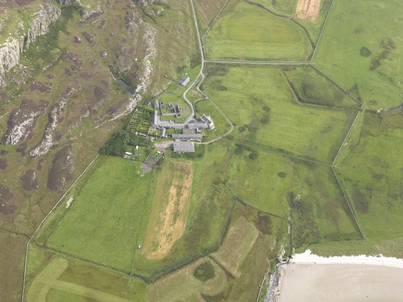 Oblique aerial view of Oronsay Farm and Priory, taken from the WNW.