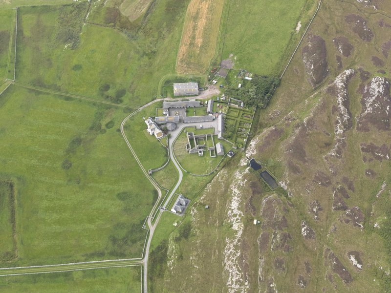 Oblique aerial view of Oronsay Farm and Priory, taken from the SE.