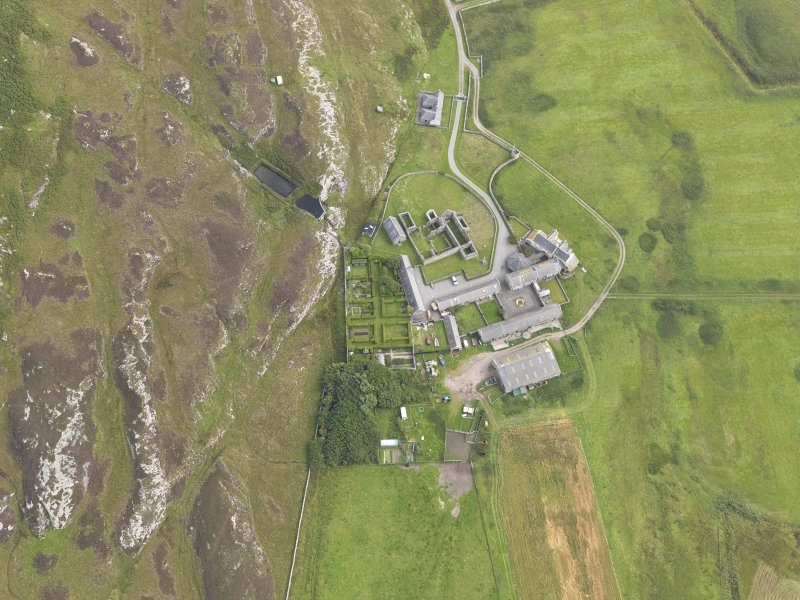 Oblique aerial view of Oronsay Farm and Priory, taken from the NW.