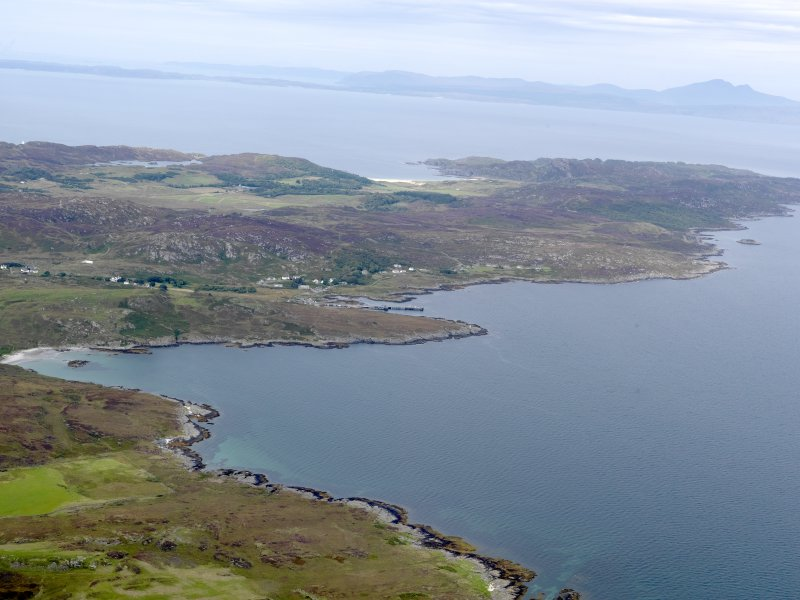 General oblique aerial view of N Colonsay, looking towards Loch Staosnaig, Port an Obain, Kiloran Bay and Mull, taken from the SE.