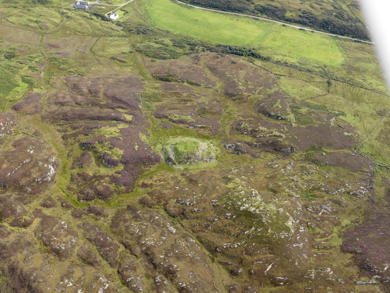 Oblique aerial view of Dun Eibhinn and Scalasaig Farm, taken from the NW.