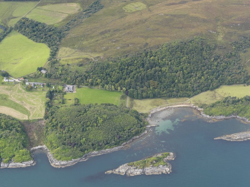 Oblique aerial view of Ardlussa and Port nam Meirleach, Jura, taken from the SE.