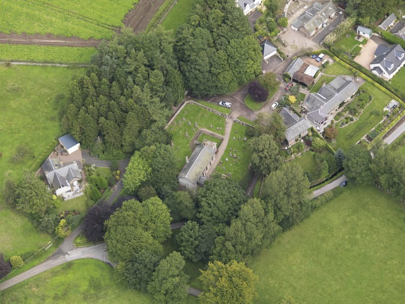 General oblique aerial view of the village centred on the church taken from the WSW.