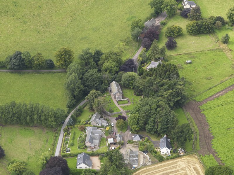 General oblique aerial view of the village centred on the church taken from the E.