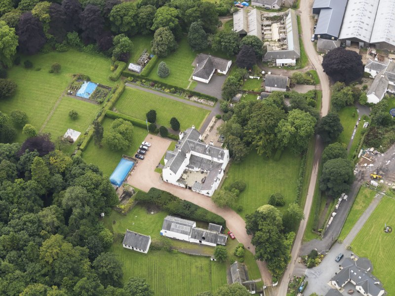 Oblique aerial view centred on the mansion taken from the NW.
