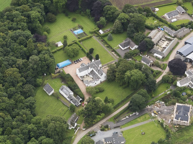 Oblique aerial view centred on the mansion taken from the N.