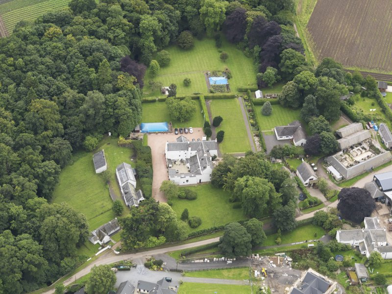 Oblique aerial view centred on the mansion taken from the NNW.