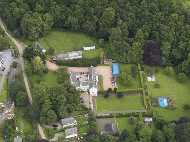 Oblique aerial view centred on the mansion taken from the SW.