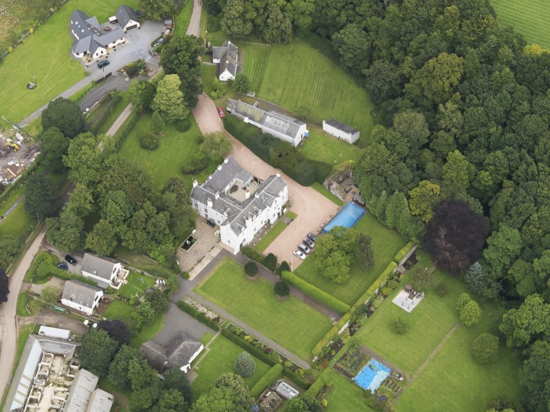 Oblique aerial view centred on the mansion taken from the SSW.