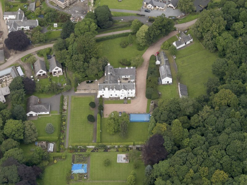 Oblique aerial view centred on the mansion taken from the SSE.