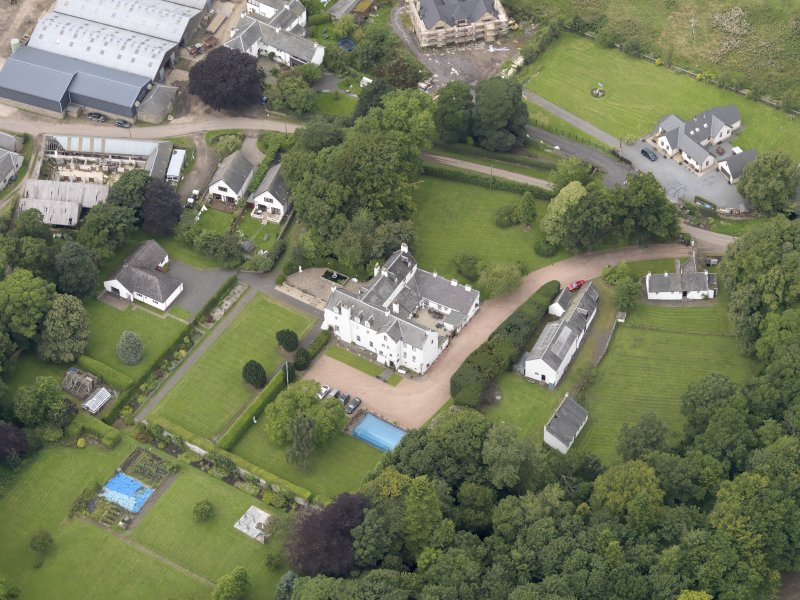 Oblique aerial view centred on the mansion taken from the SE.