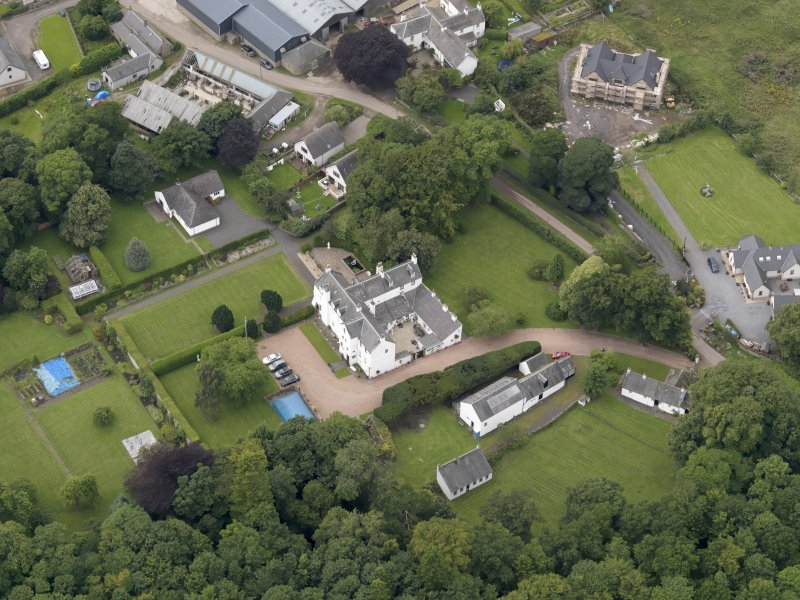 Oblique aerial view centred on the mansion taken from the ESE.