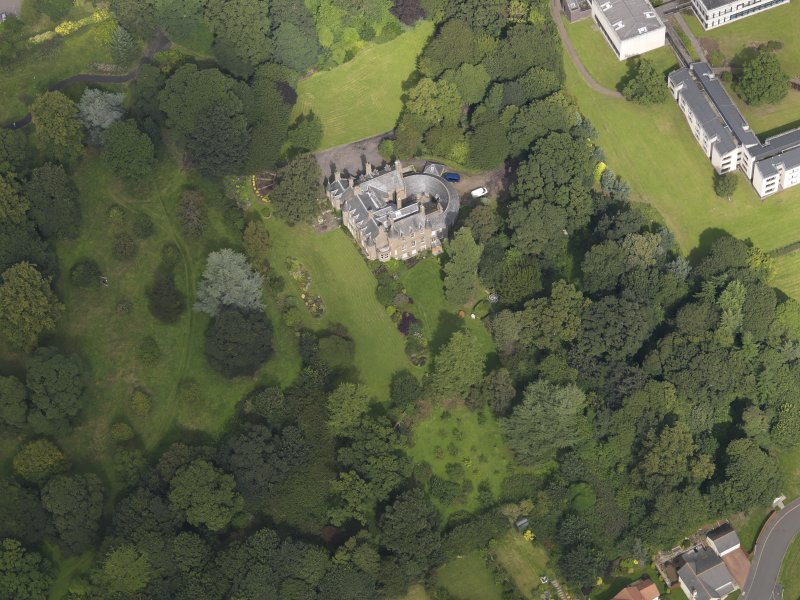 Oblique aerial view of the house taken from the SSW.