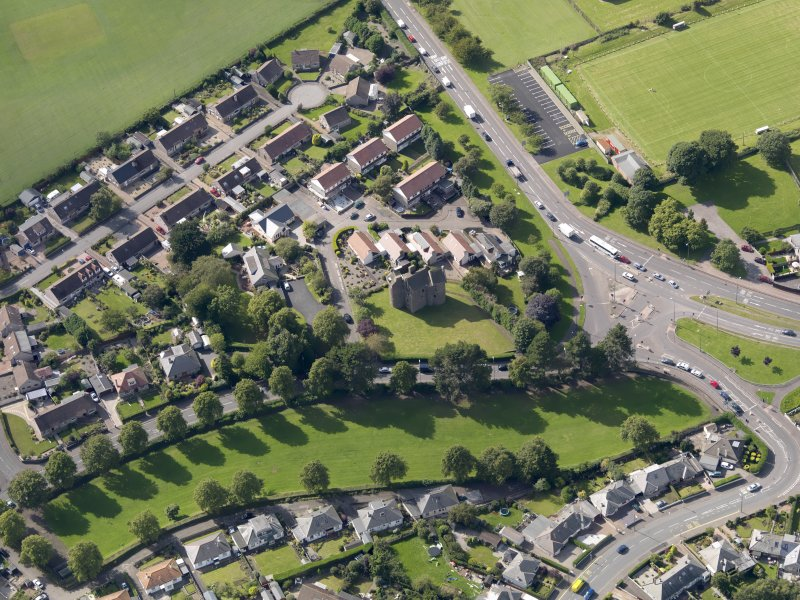 Oblique aerial view of Claypotts Castle taken from the E.