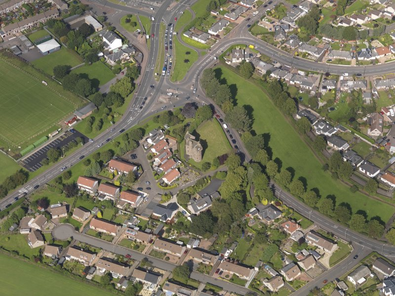 Oblique aerial view of Claypotts Castle taken from the SW.
