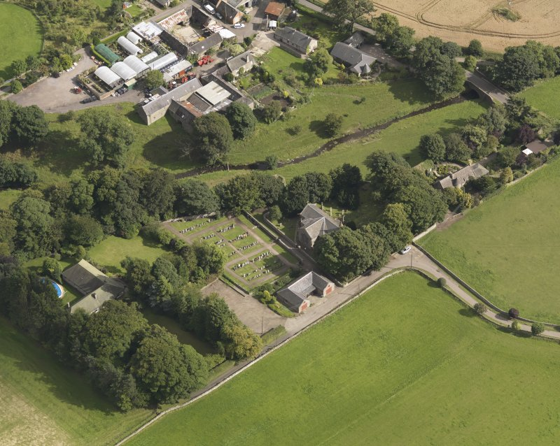 General oblique aerial view of the Murroes Estate centred on the church taken from the NW.