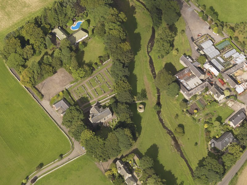 General oblique aerial view of the Murroes Estate centred on the church taken from the SW.