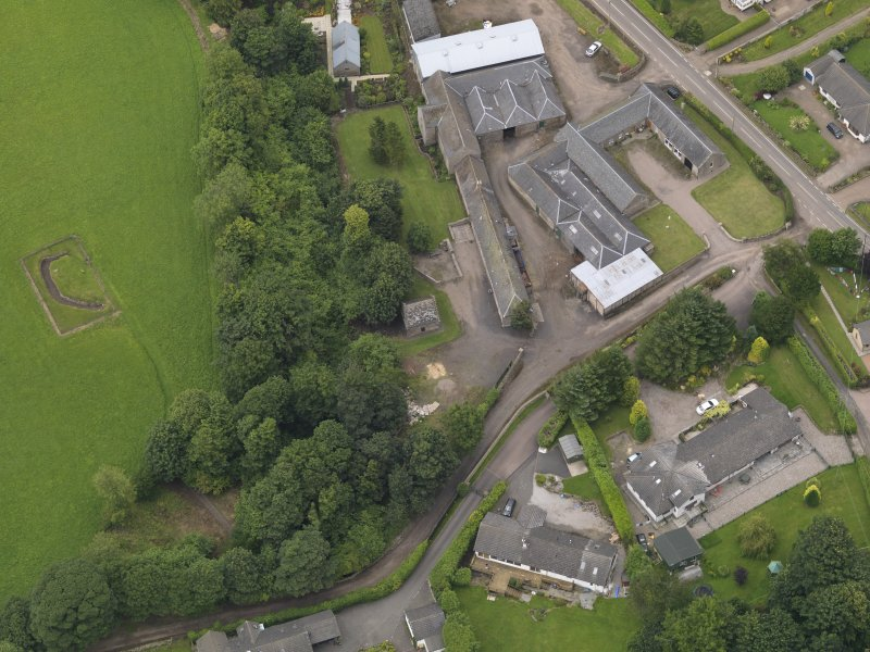 General oblique aerial view of the Tealing Home Farm centred on the dovecot taken from the S.