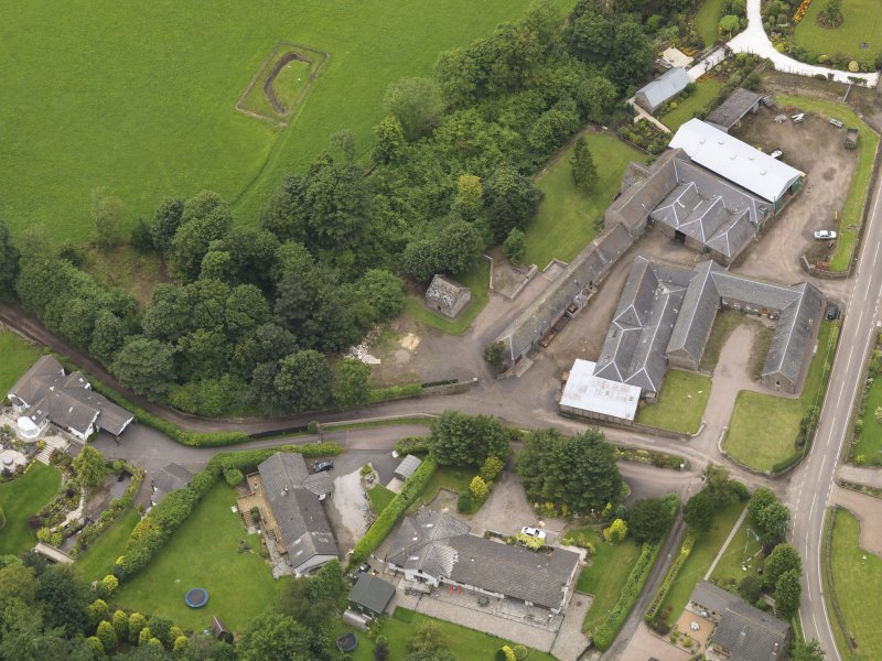 General oblique aerial view of the Tealing Home Farm centred on the dovecot taken from the SE.