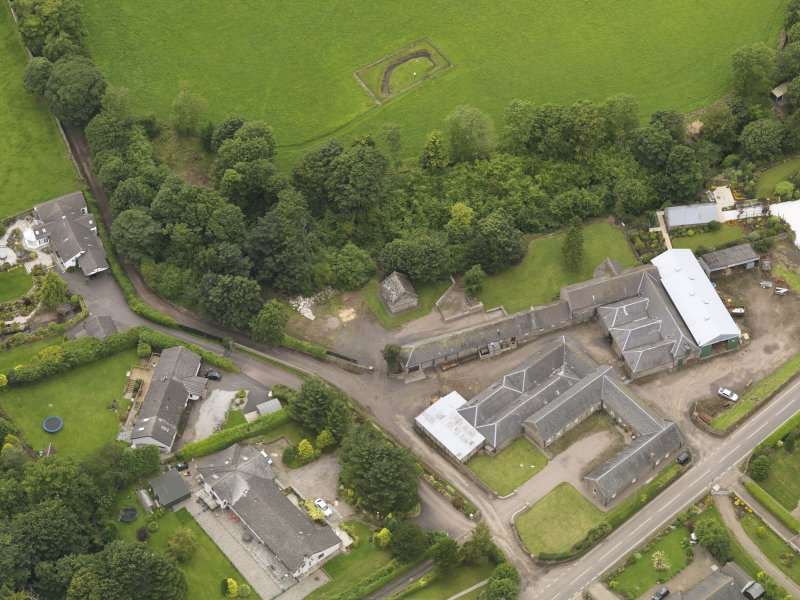 General oblique aerial view of the Tealing Home Farm centred on the dovecot taken from the E.